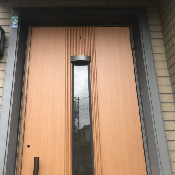 After:玄関ドアシート貼り